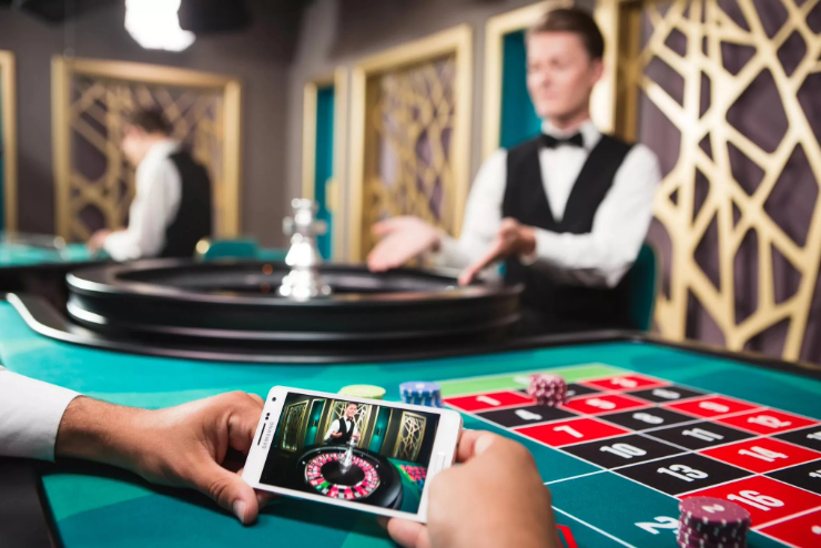 a person using online casino app on his phone